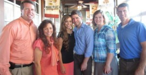 Guinn and Michael Seewald (far right) are standing with the Duggars.
